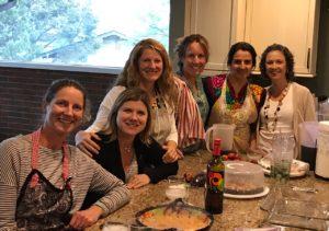 Friends cooking Mexican food at Cocina Corazón
