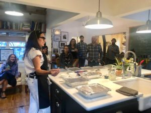 Barbara explaining dishes to the guests